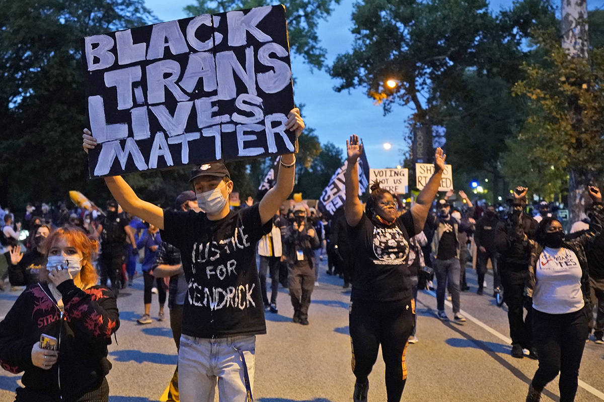 Protesters march through the streets near the debate hall, Tuesday, Sept. 29, 2020, in Clevelan ...
