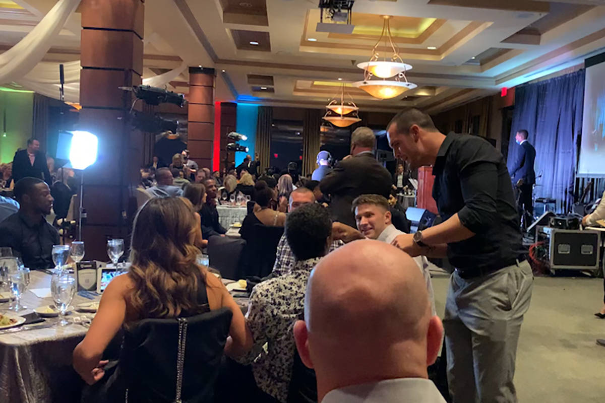 Derek Carr is seen mingling with others without a mask at Darren Waller's foundation event on M ...