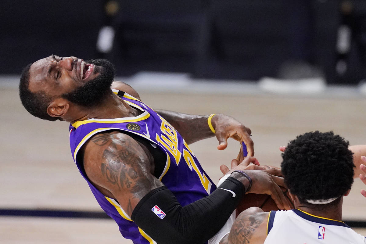 Los Angeles Lakers' LeBron James (23) falls backwards during a play in the second half of an NB ...