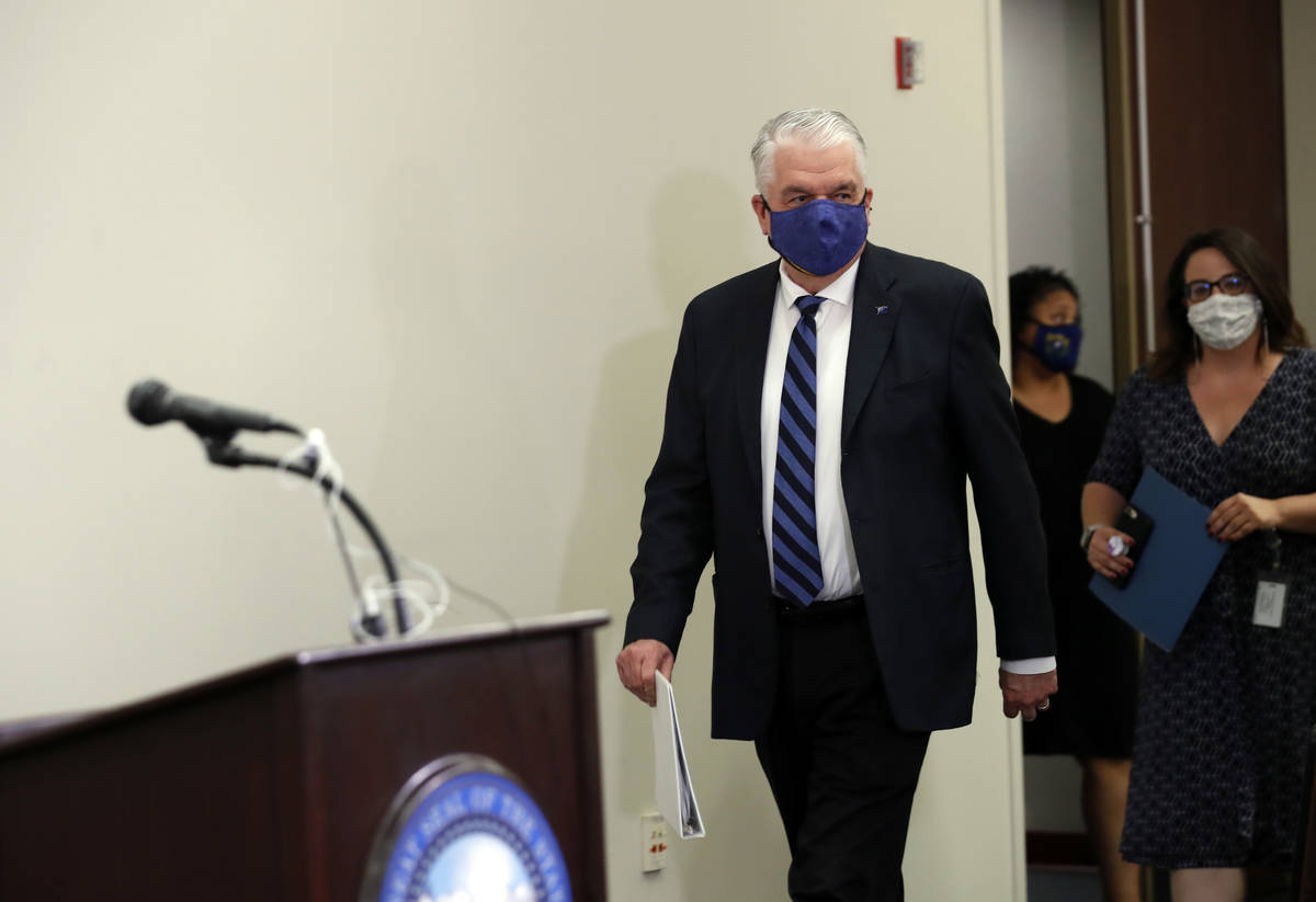 Nevada Governor Steve Sisolak arrives for a news conference at the Grant Sawyer State Building ...