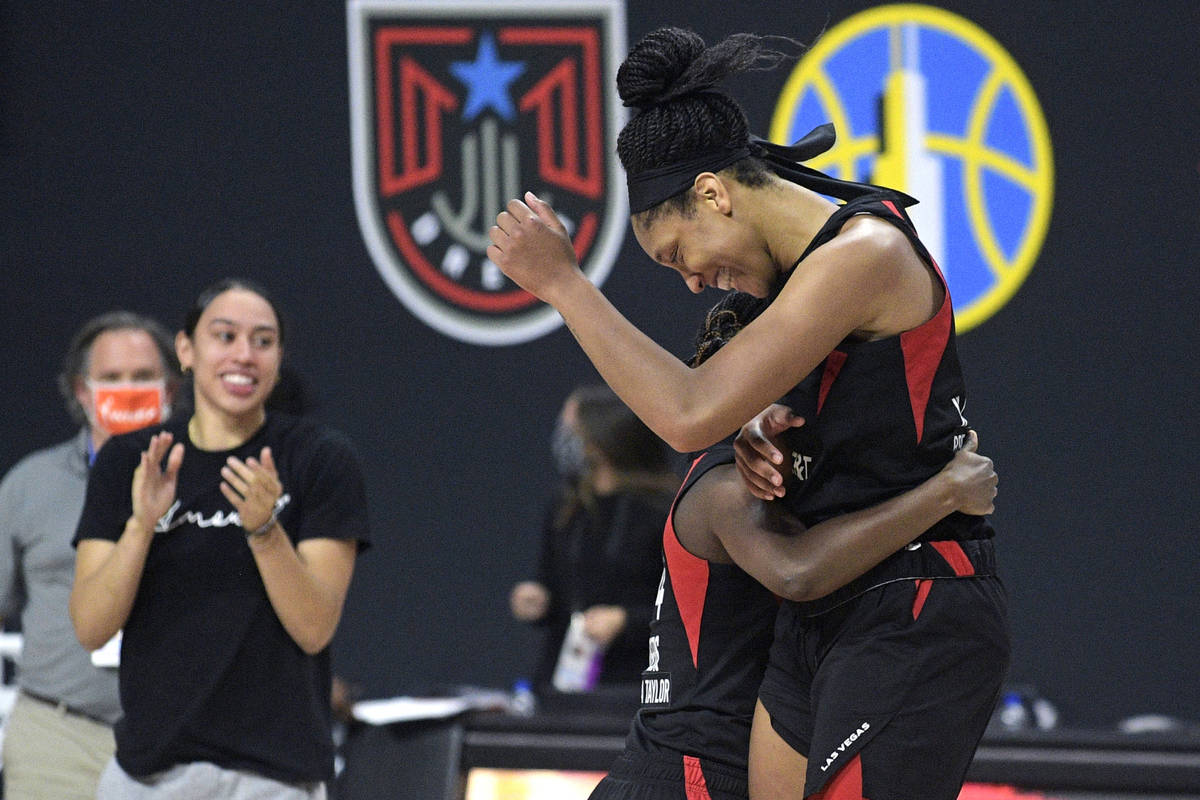 Las Vegas Aces center A'ja Wilson, right, and guard Sugar Rodgers celebrate after getting the w ...