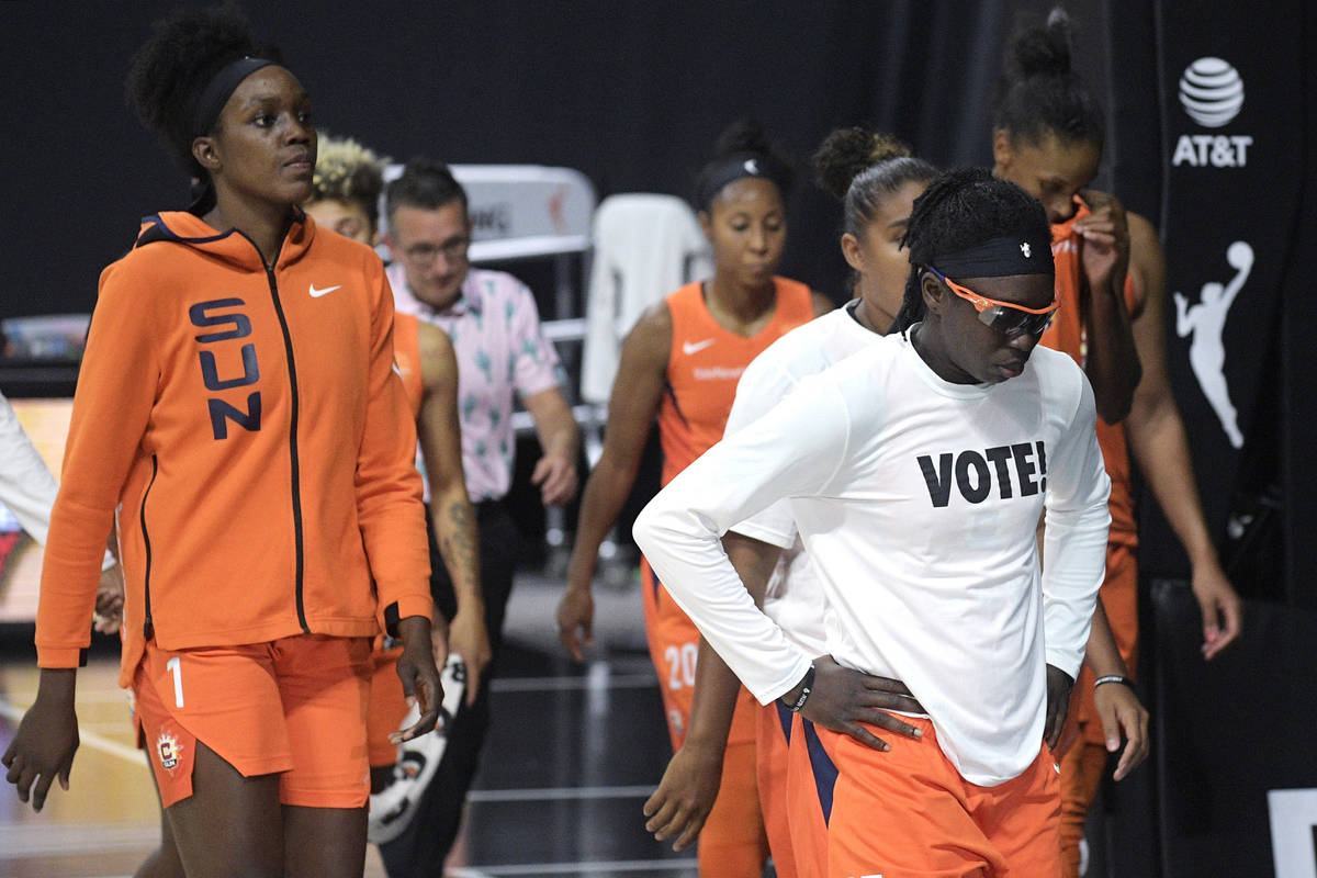 Connecticut Sun players leave the court after losing to the Las Vegas Aces in Game 5 of a WNBA ...
