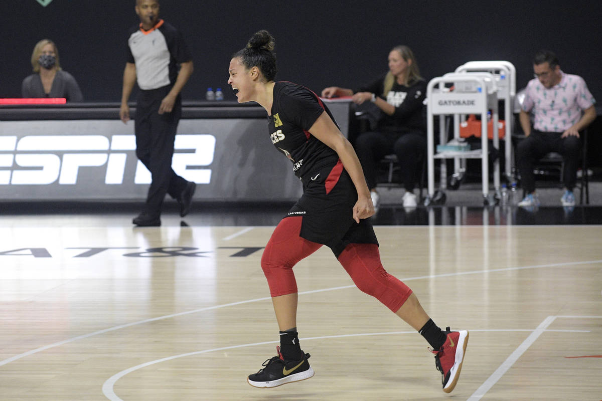 Las Vegas Aces guard Kayla McBride celebrates after getting the win over the Connecticut Sun in ...