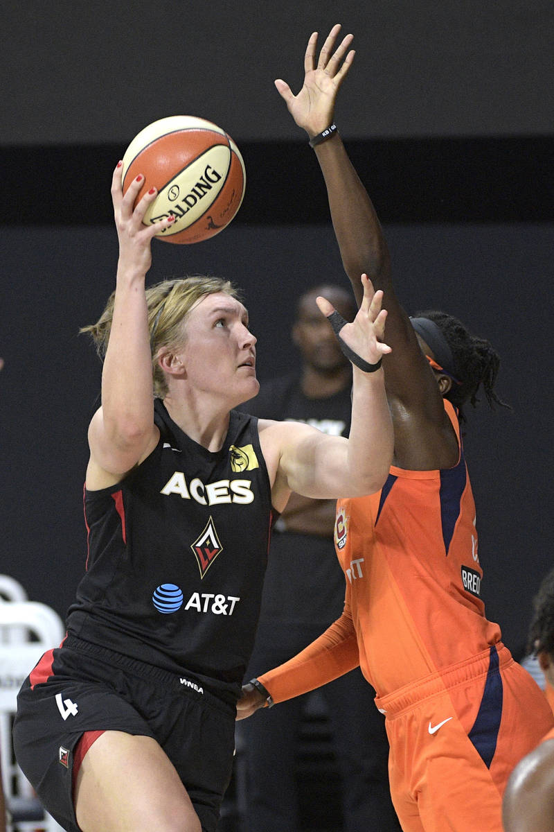 Las Vegas Aces center Carolyn Swords (4) goes up for a shot in front of Connecticut Sun guard E ...