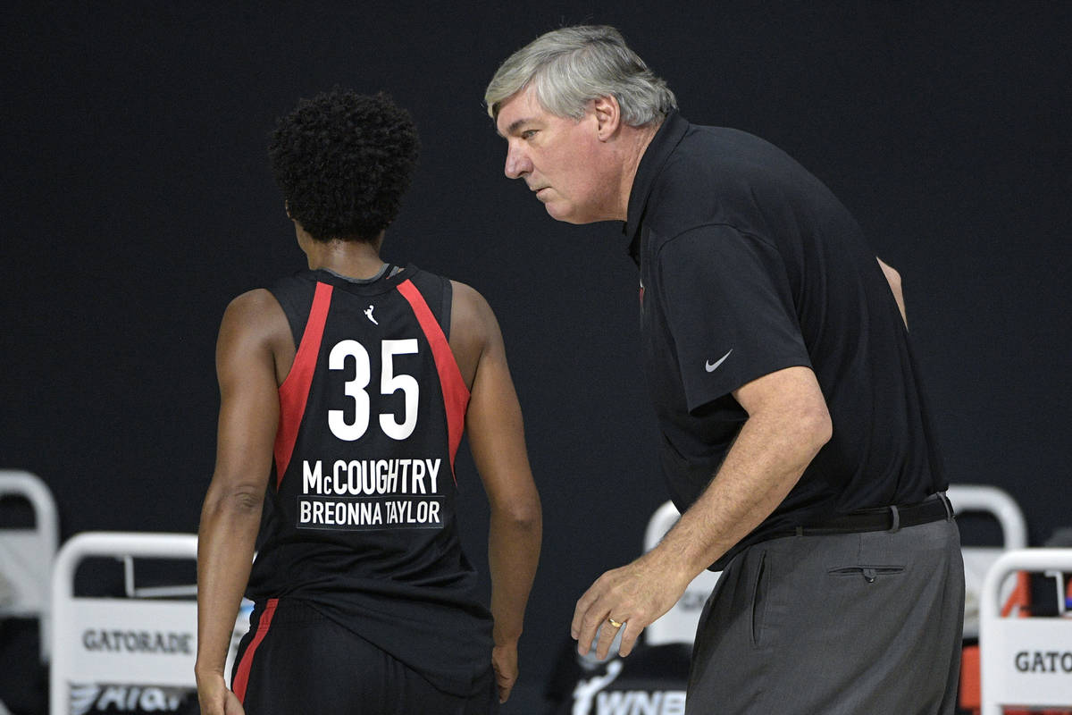 Las Vegas Aces head coach Bill Laimbeer, right, talks with forward Angel McCoughtry (35) during ...