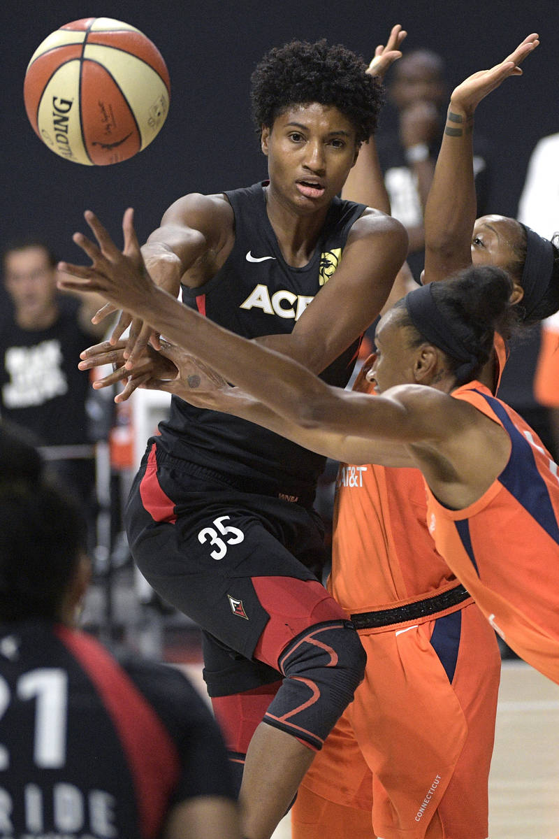 Las Vegas Aces forward Angel McCoughtry (35) passes the ball in front of Connecticut Sun guard ...