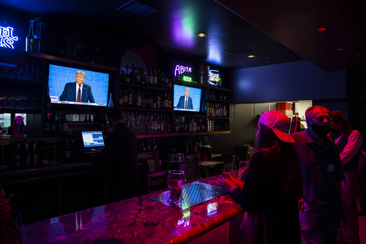Supporters of President Donald Trump watch while ordering at the bar during a debate watch part ...
