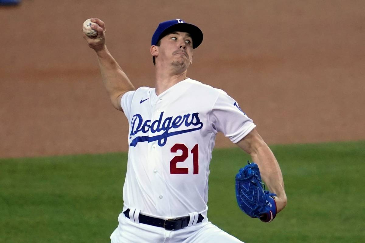 Los Angeles Dodgers starter Walker Buehler throws to an Oakland Athletics batter during the fir ...