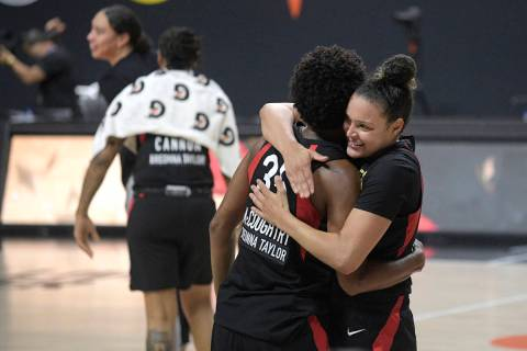 Las Vegas Aces forward Angel McCoughtry (35) and guard Kayla McBride, right, celebrate after Ga ...