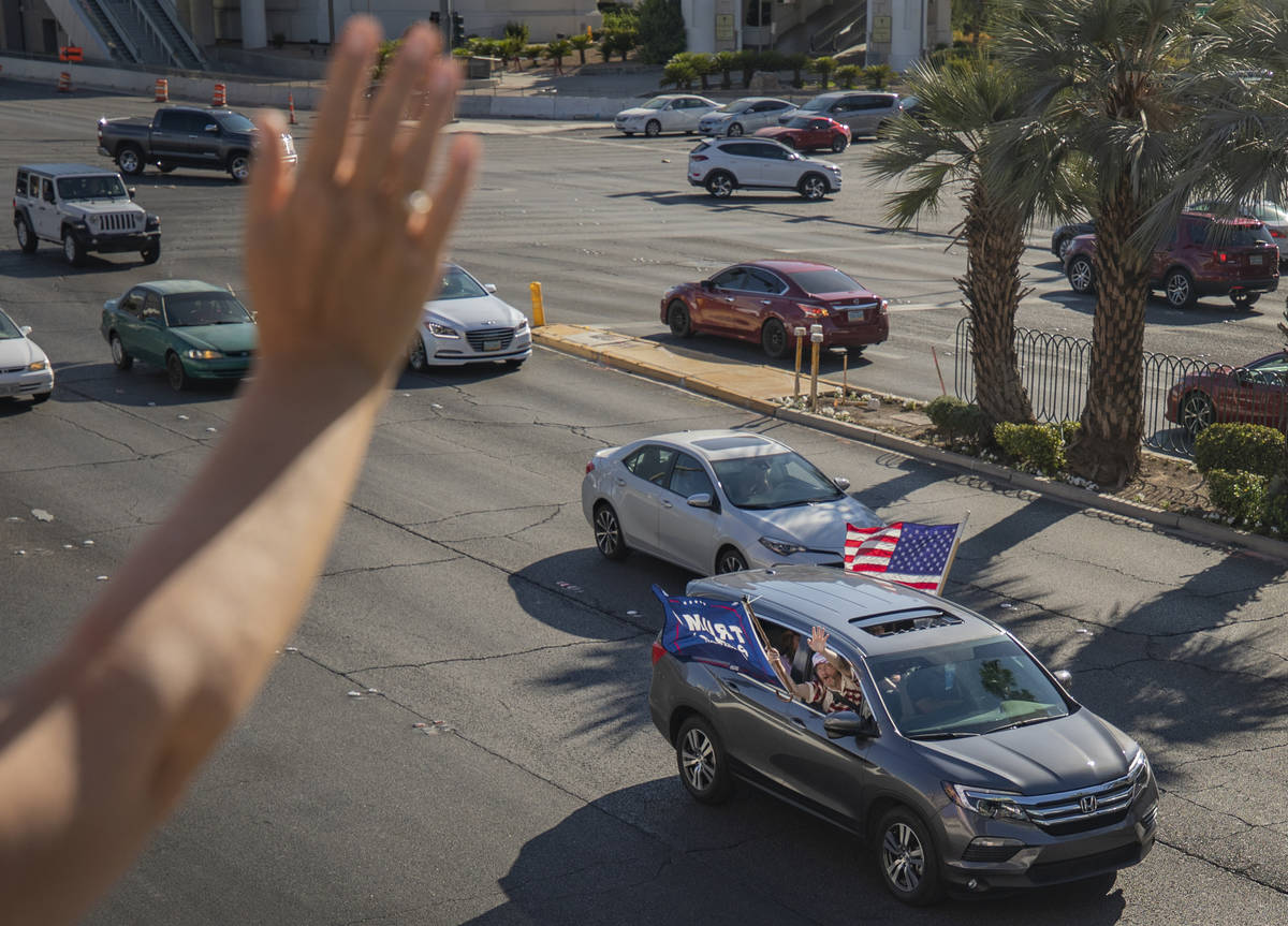 Hope Moore of Rock Hill, South Carolina, waves in support as a caravan of Trump supporters ride ...