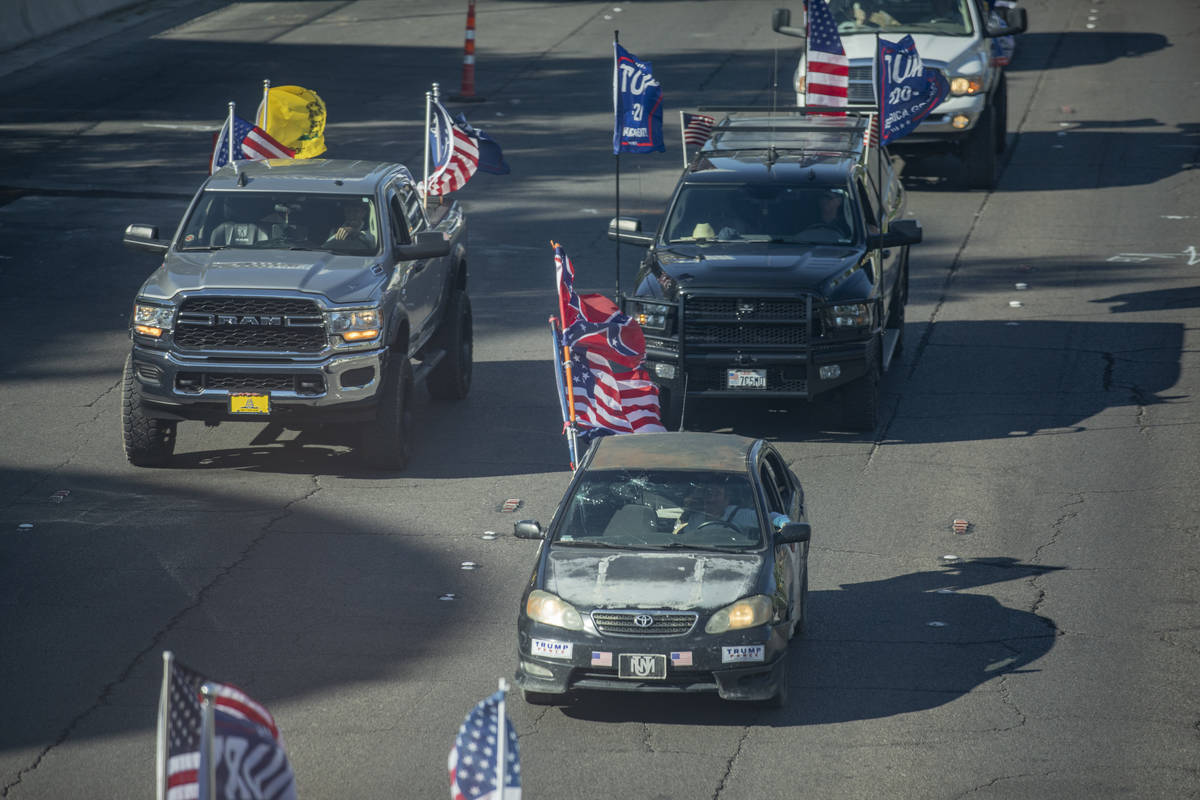 A caravan of Trump supporters ride down the Las Vegas Strip, on Wednesday, Sept. 30, 2020. (Eli ...