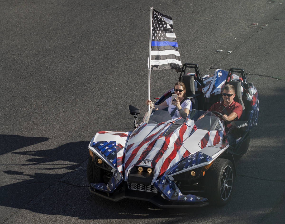 A car taking part in a caravan of Trump and police support, rides down the Las Vegas Strip, on ...
