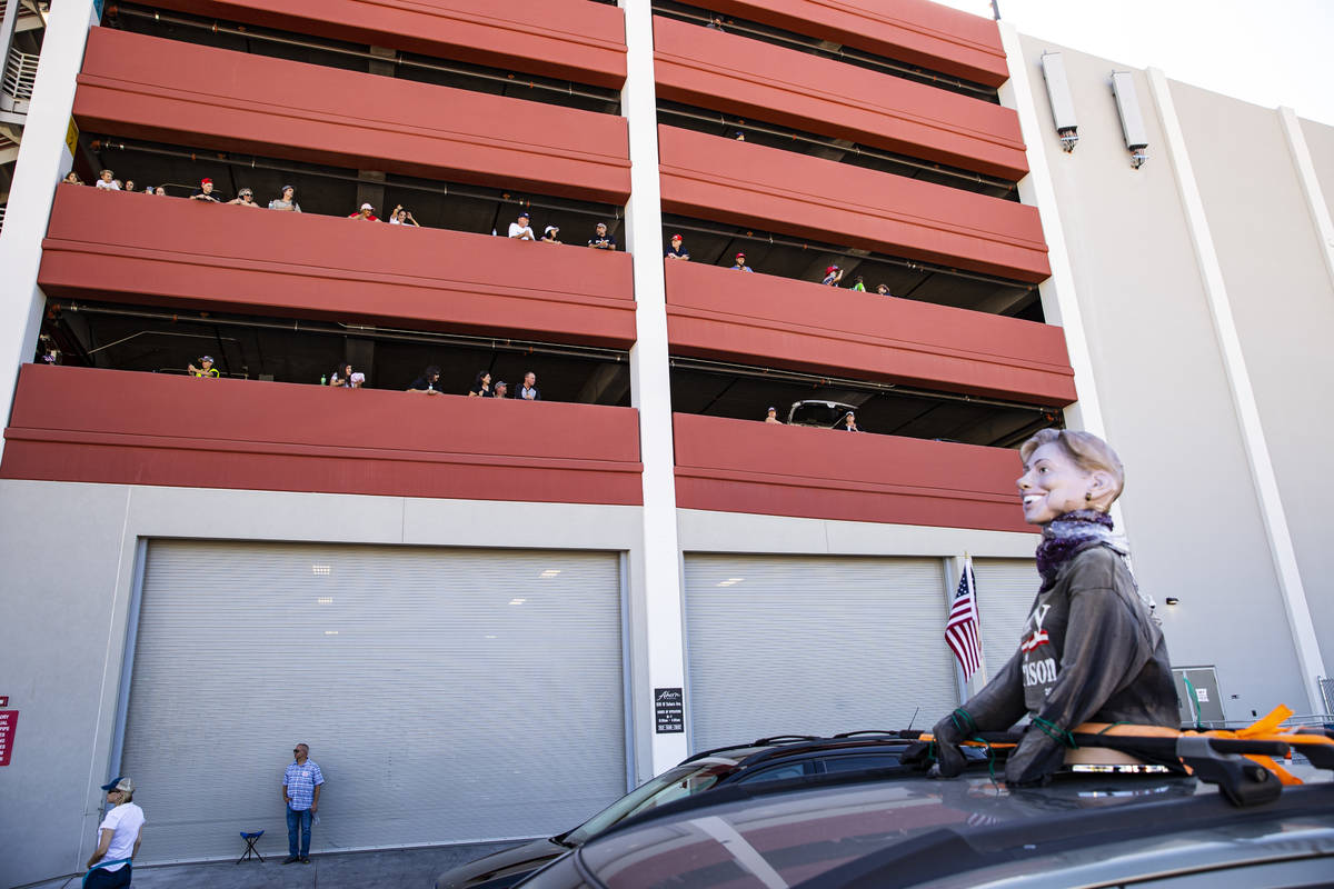 People watch from the parking garage of the Ahern Hotel as supporters of law enforcement and Pr ...