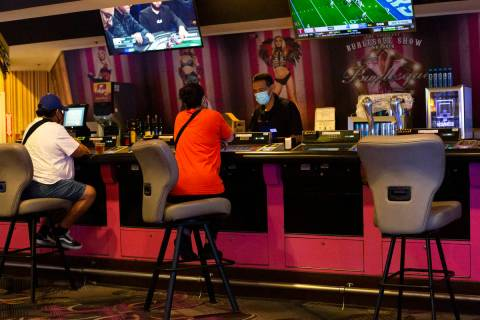 Chairs at a bar in the Flamingo Las Vegas are spaced out to maintain social distance on Monday, ...