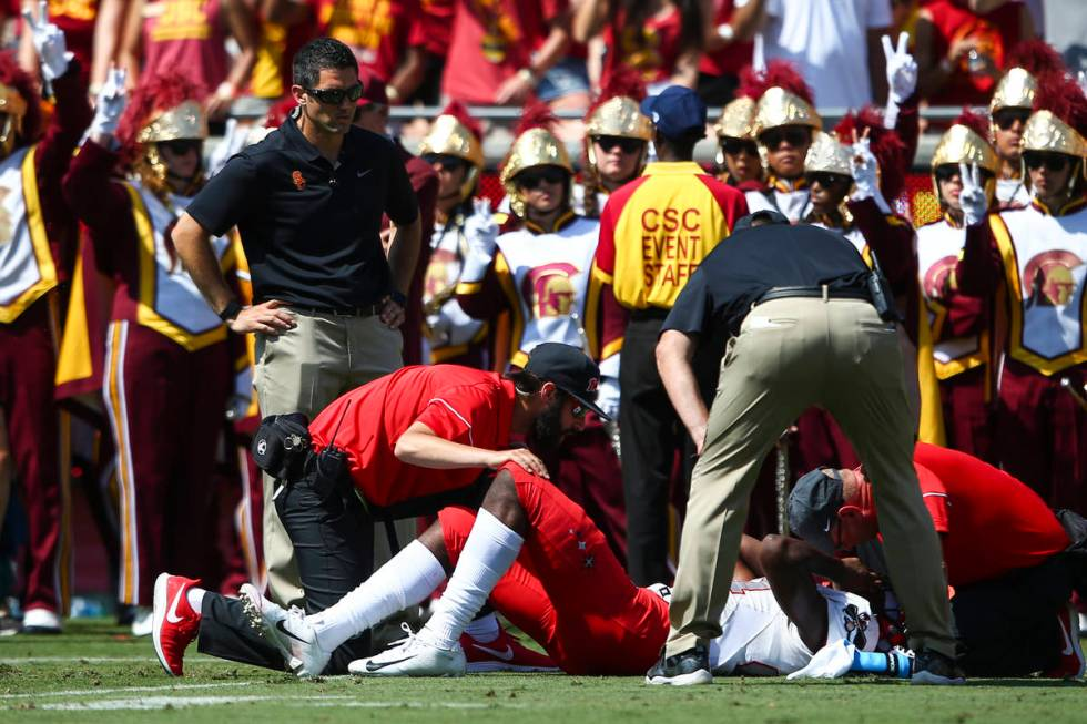 Medical officials check on UNLV Rebels wide receiver Kendal Keys (84) during the first half of ...