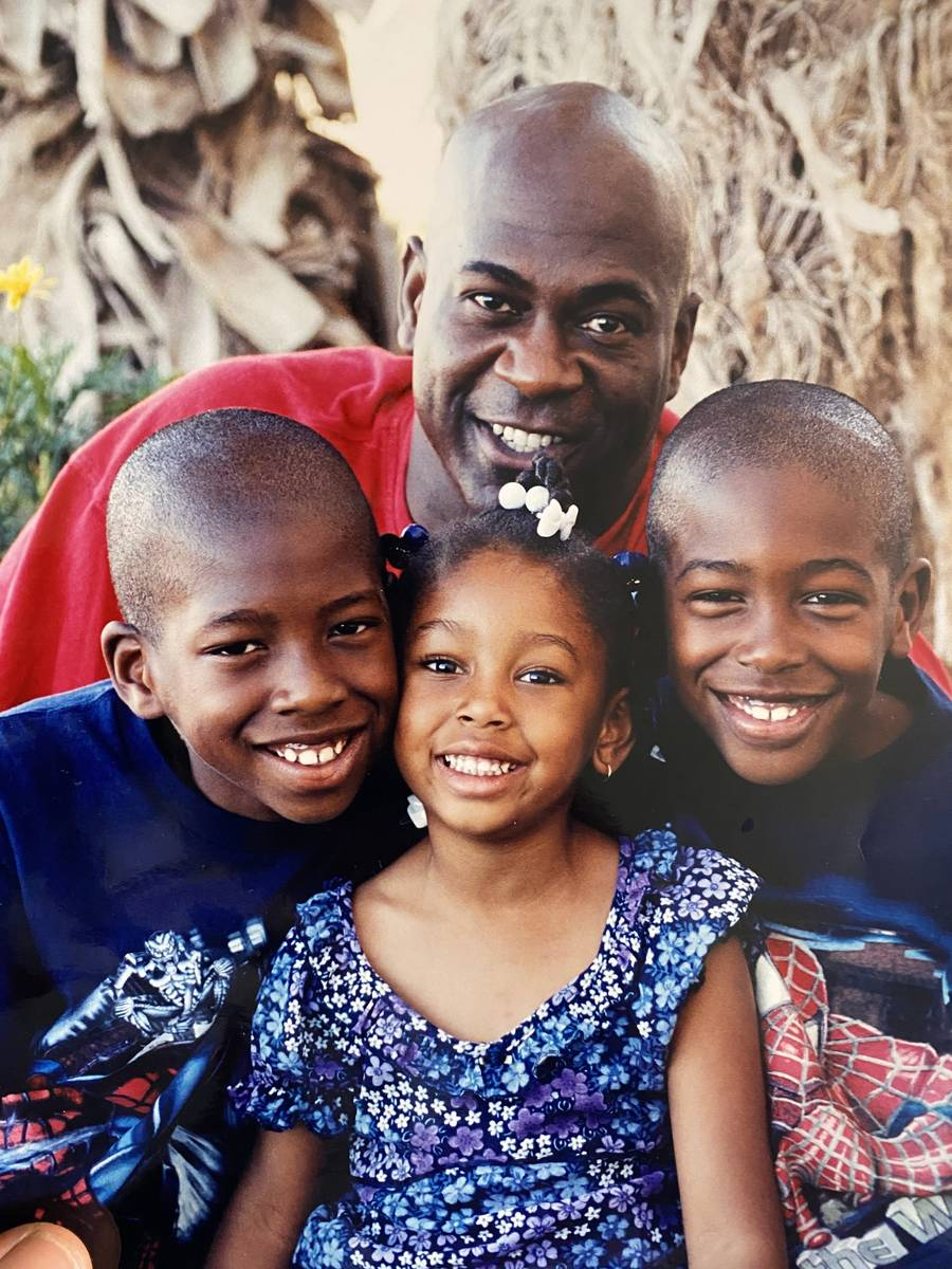 Kenny Keys (right) poses for a photo with his father, Kenny Sr. (top), brother, Kendal (left) a ...