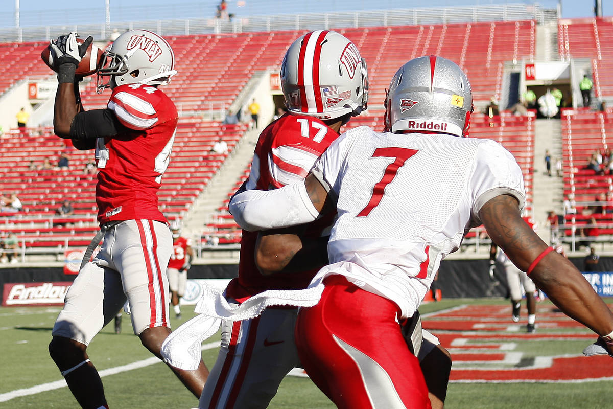 UNLV's Kenny Keys (44) intercepts a pass intended for New Mexico's Lamaar Thomas (7) during the ...