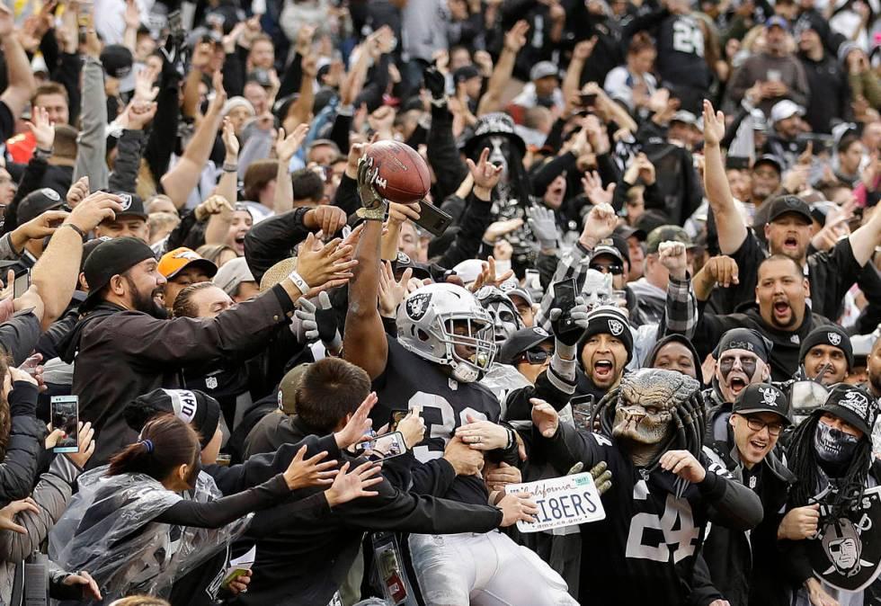 Oakland Raiders running back Jalen Richard (30) celebrates with fans after scoring a touchdown ...