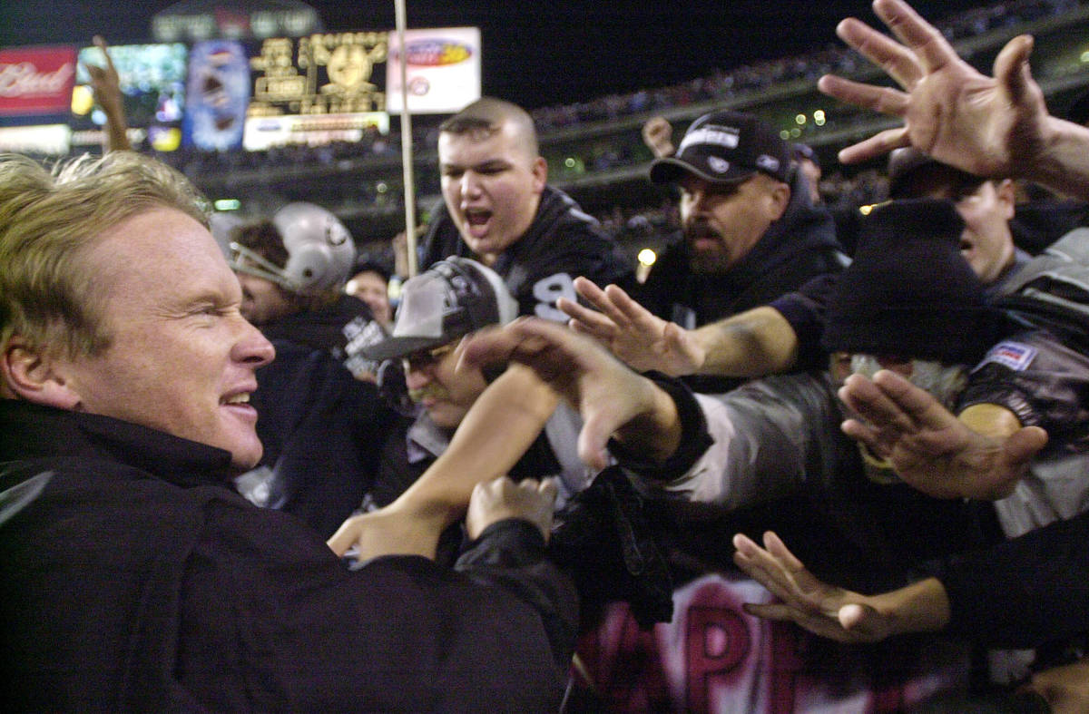 FILE - In this Jan. 12, 2002, file photo, Oakland Raiders head coach Jon Gruden greets fans in ...