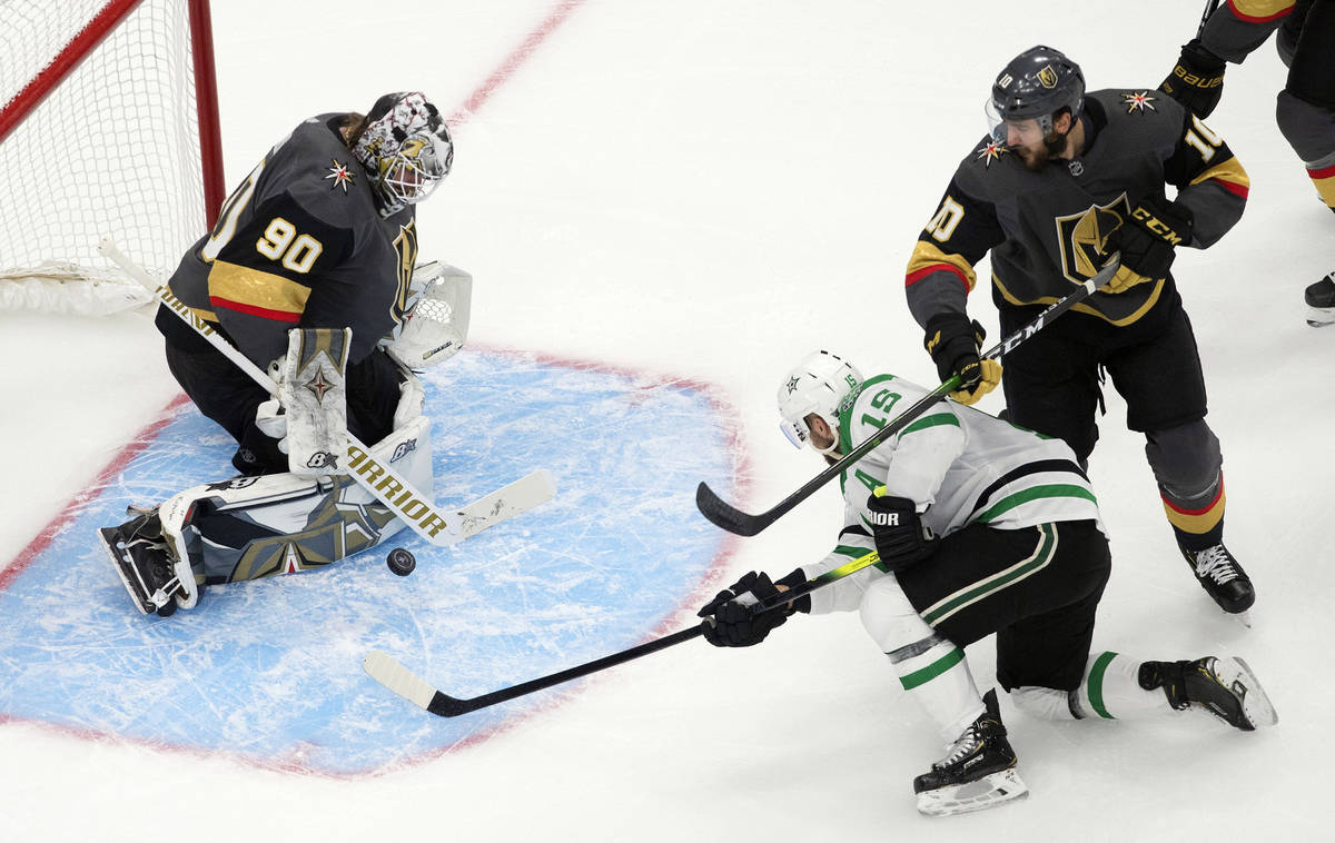 Dallas Stars' Blake Comeau (15) is stopped by Vegas Golden Knights goalie Robin Lehner (90) as ...