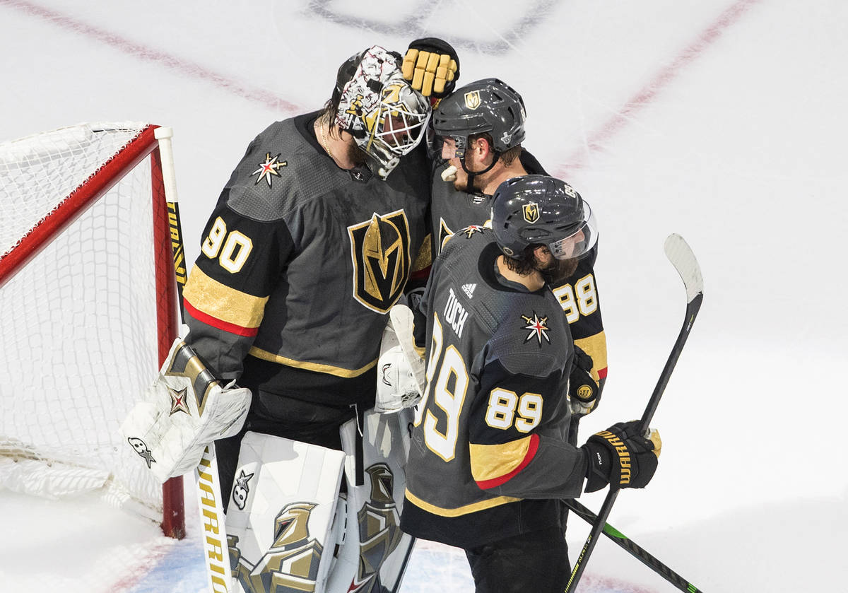 Vegas Golden Knights goalie Robin Lehner (90) and teammates Nate Schmidt (88) and Alex Tuch (89 ...