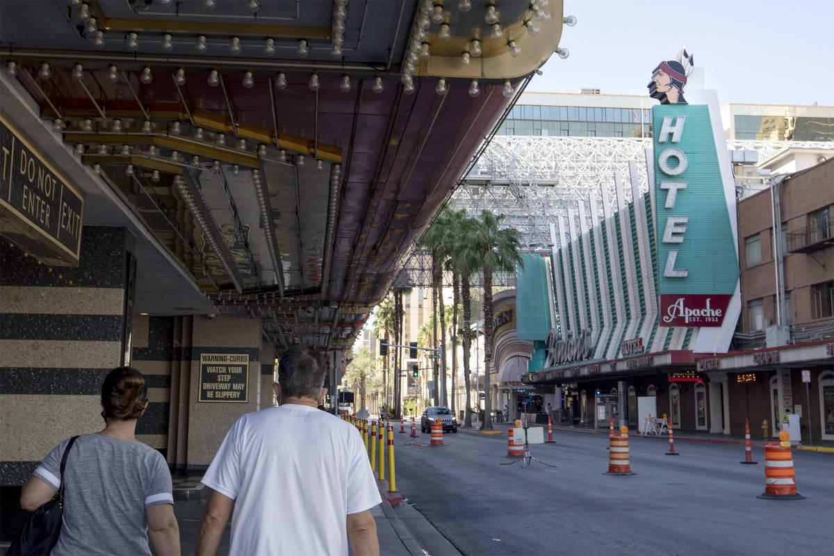 People walk by Hotel Apache in downtown Las Vegas on Tuesday, Sept. 29, 2020. (Ellen Schmidt/La ...