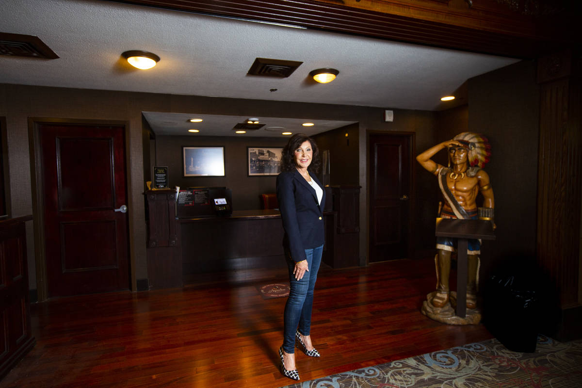 Gina Silvagni Perry, granddaughter of P.O. Silvagni, who opened Hotel Apache in 1932, poses for ...