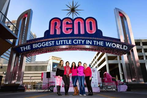 Taking in the pink lights of the Reno Arch in October 2019 are some of Paint Nevada Pink's or ...