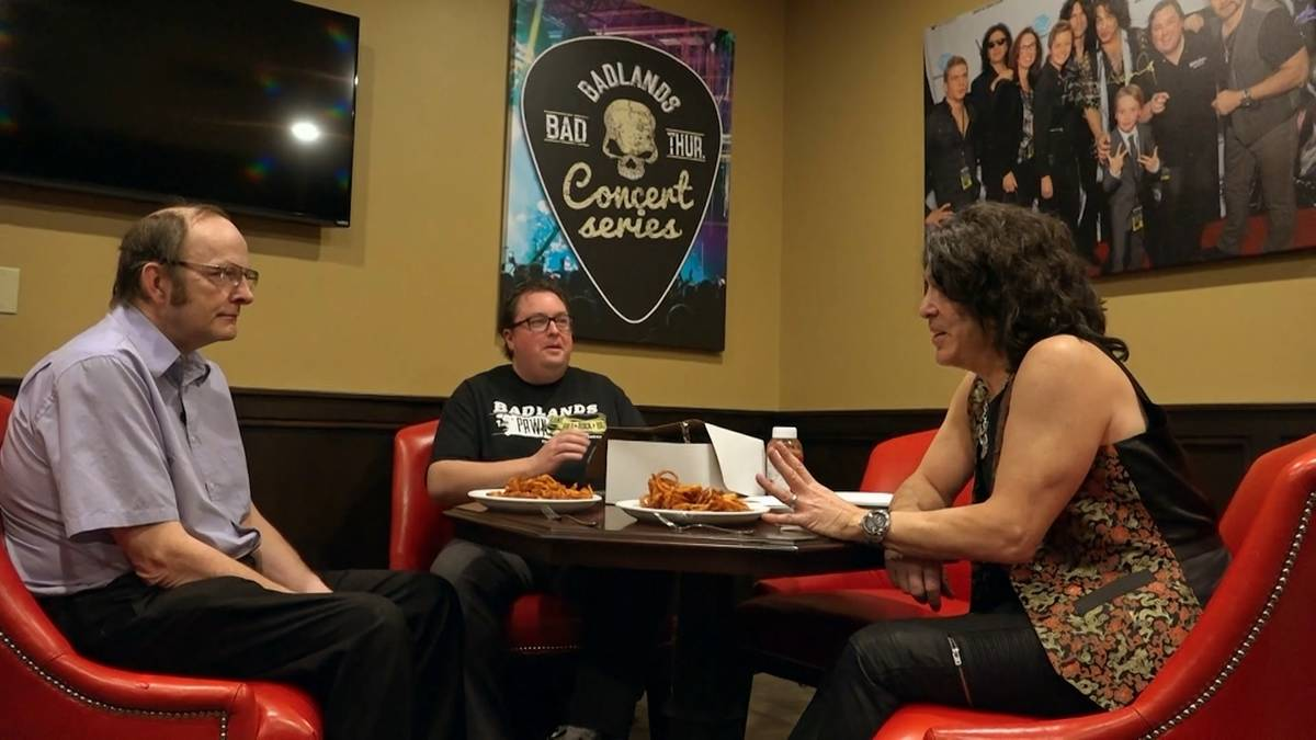 From left, Larry Lang sits down with Las Vegas-based Dollar Loan Center CEO Chuck Brennan and ...