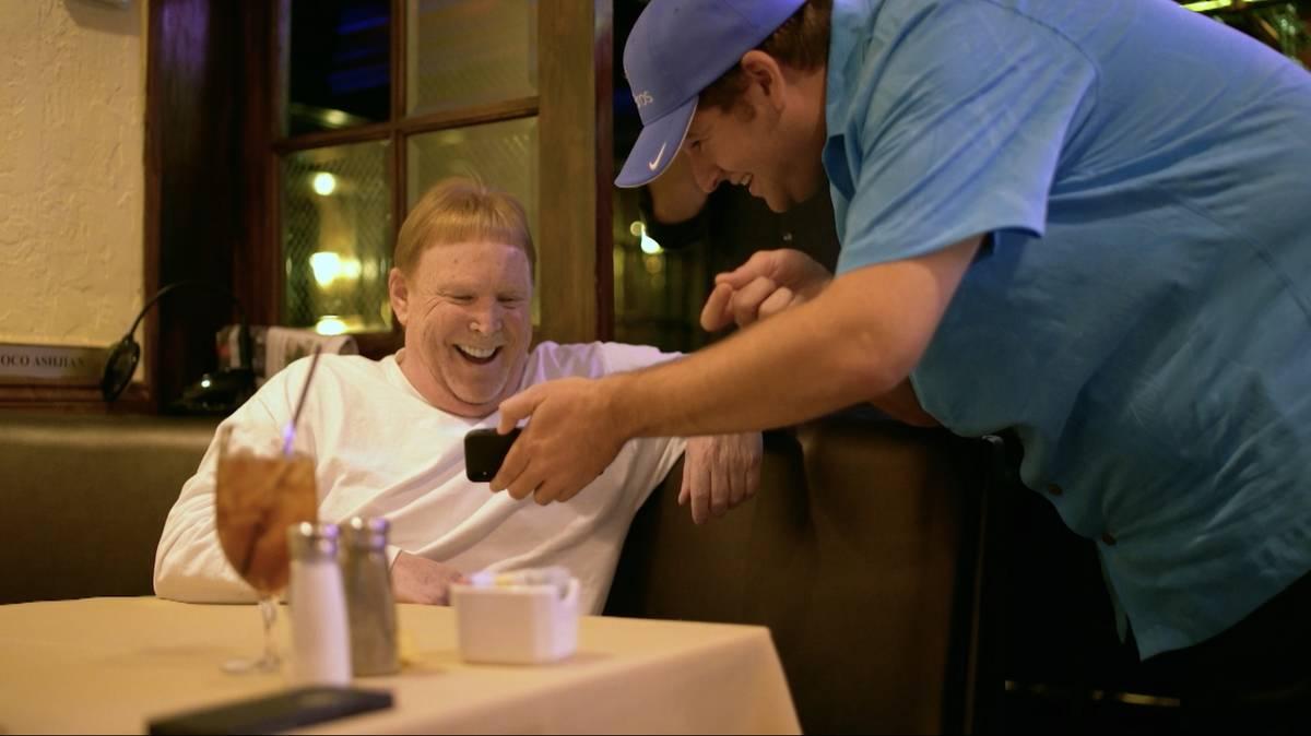 Filmmaker Zachary Capp, right, shows Las Vegas Raiders owner Mark Davis his plan for Raiders Ri ...