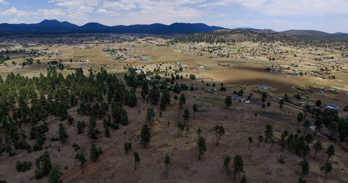 The sun shines over Flagstaff, AZ, on Aug. 1, 2020. While Flagstaff isn't within the Navajo re ...