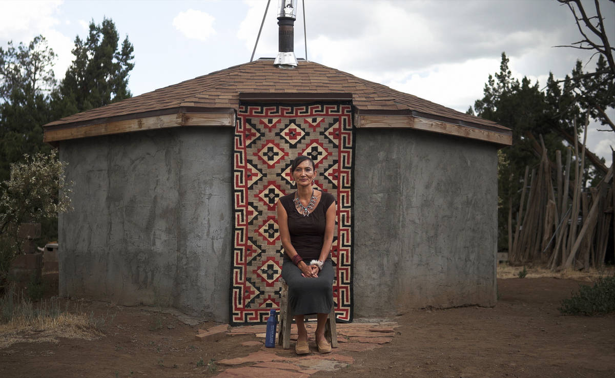 Jeneda Benally sits in front of her family's Hogan in Flagstaff, AZ, on Aug. 1, 2020, where her ...