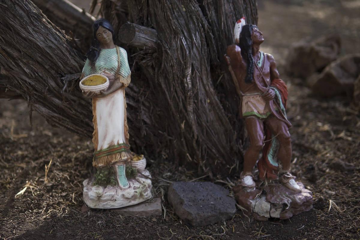 Decorative indigenous statues line the trees in Jeneda Benallyճ backyard in Flagstaff, AZ ...