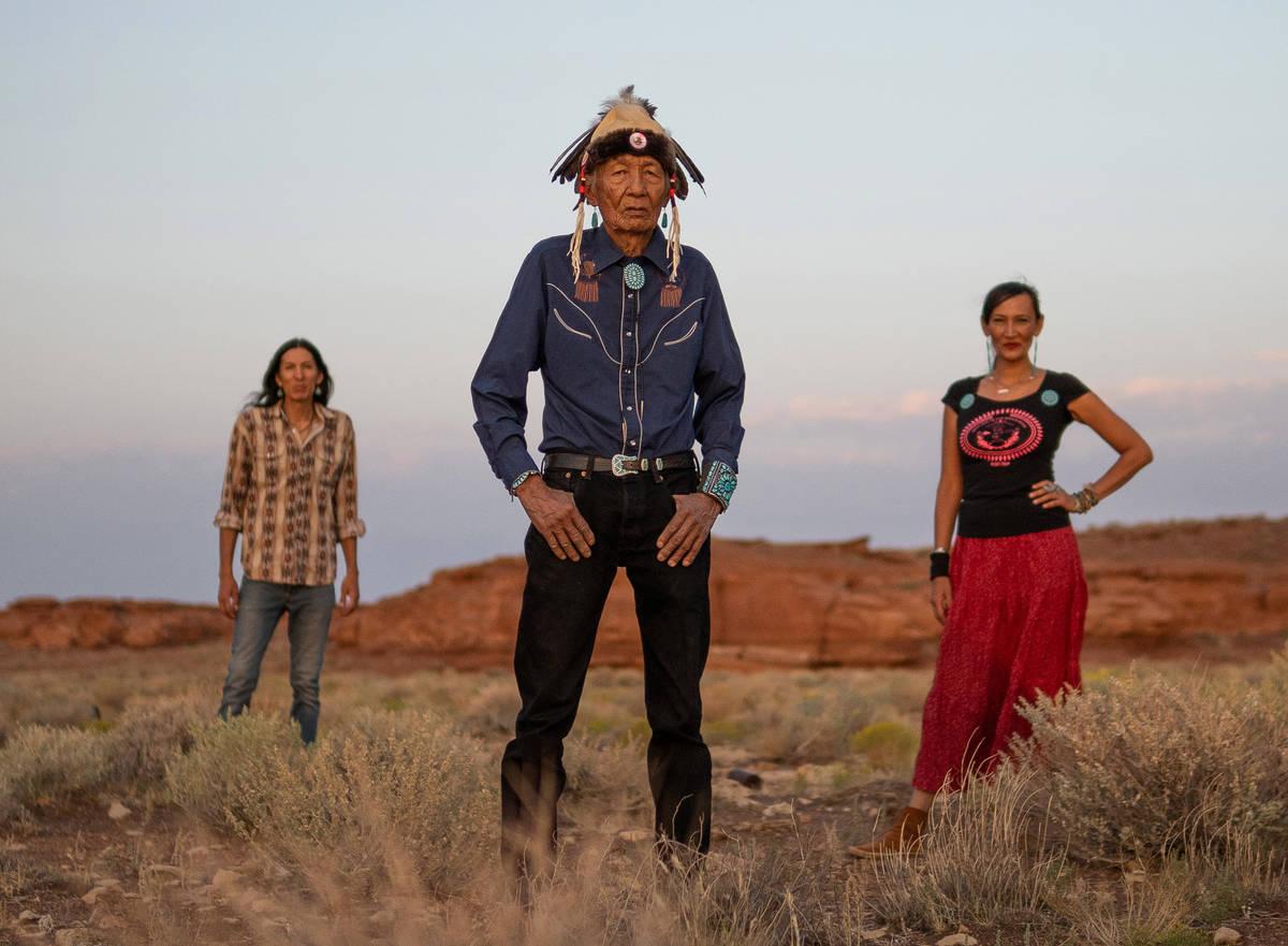 Clayson Benally, left, Jones Benally, center, and Jeneda Benally, right, pose together on the N ...