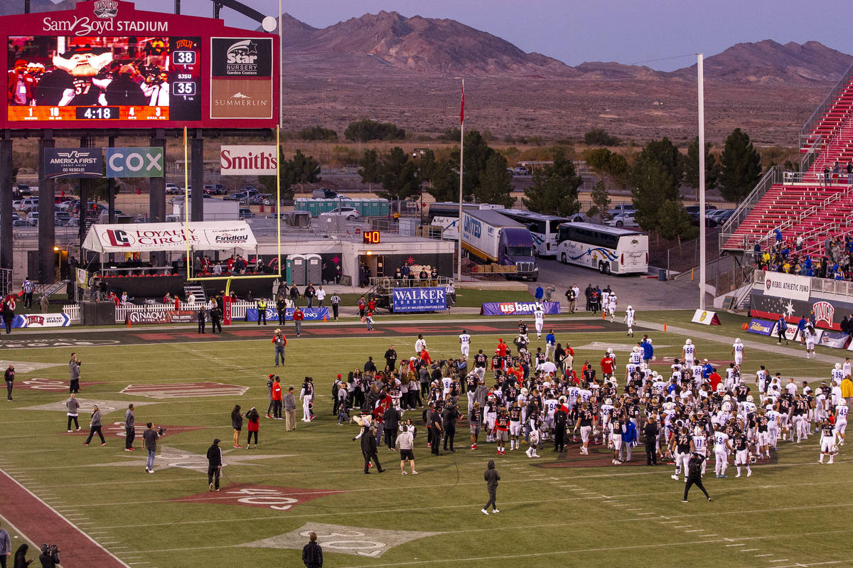 UNLV Rebels and San Jose State Spartans players and coaches come together on the field followin ...