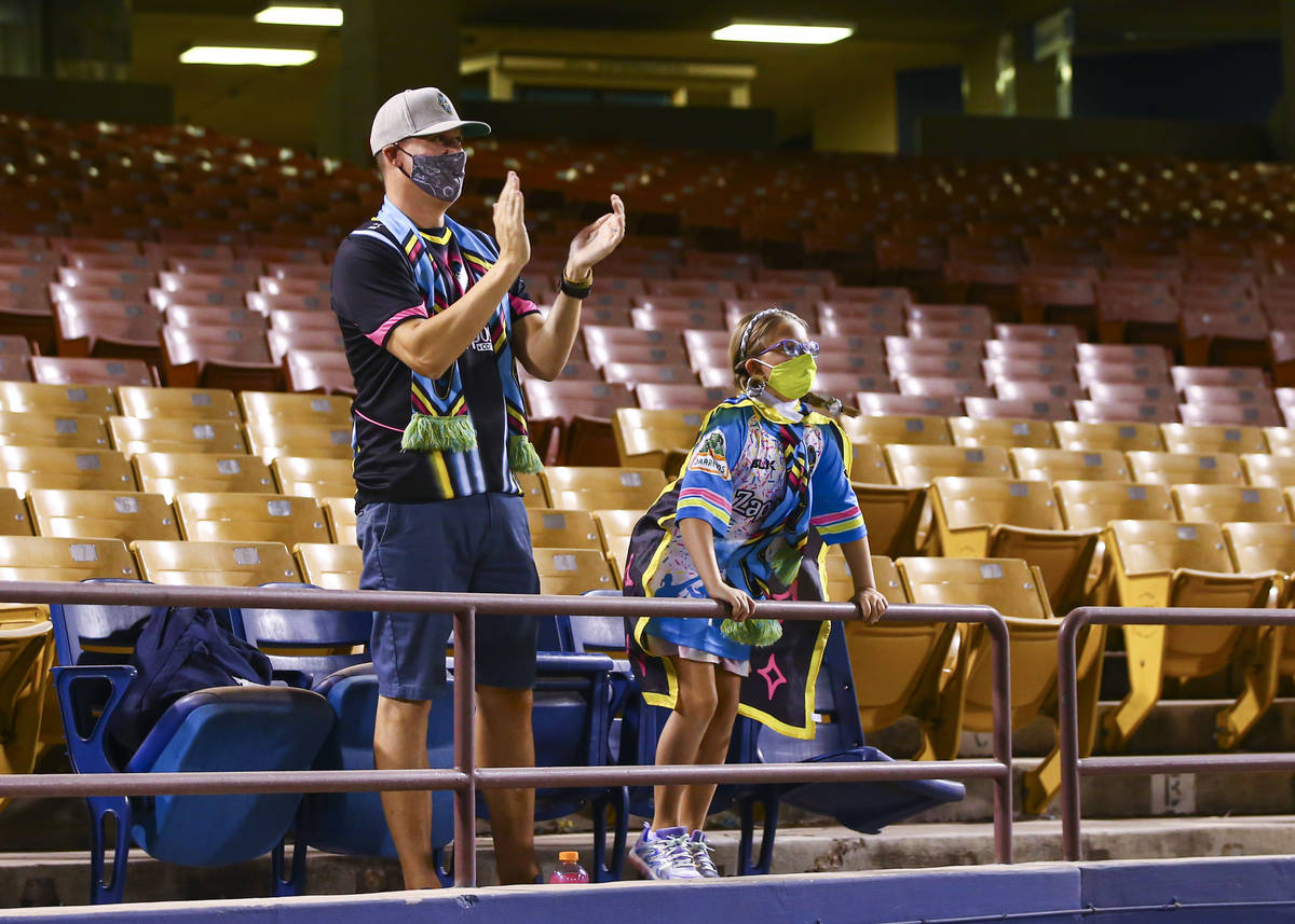 Las Vegas Lights FC fans Zac Moyle, left, with daughter Piper Moyle, 8, cheer at the start of a ...