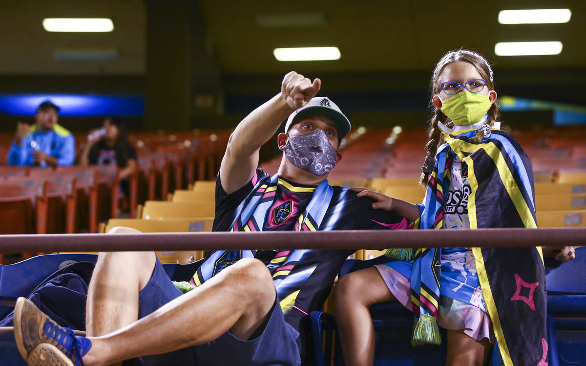 Las Vegas Lights FC fans Zac Moyle, left, with daughter Piper Moyle, 8, watch the action during ...