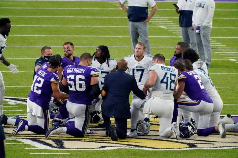 Tennessee Titans and the Minnesota Vikings players meet at midfield following an NFL football g ...