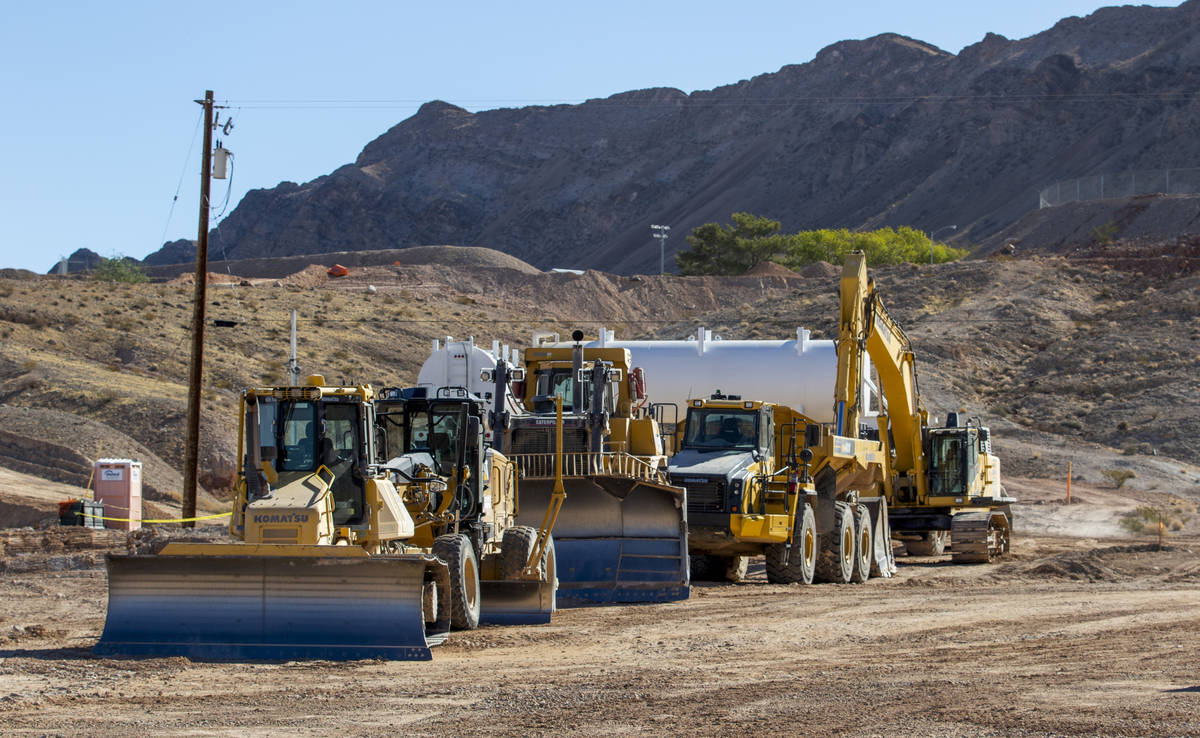 Construction vehicles are lined up on the new site of the Las Vegas Metropolitan Police Departm ...