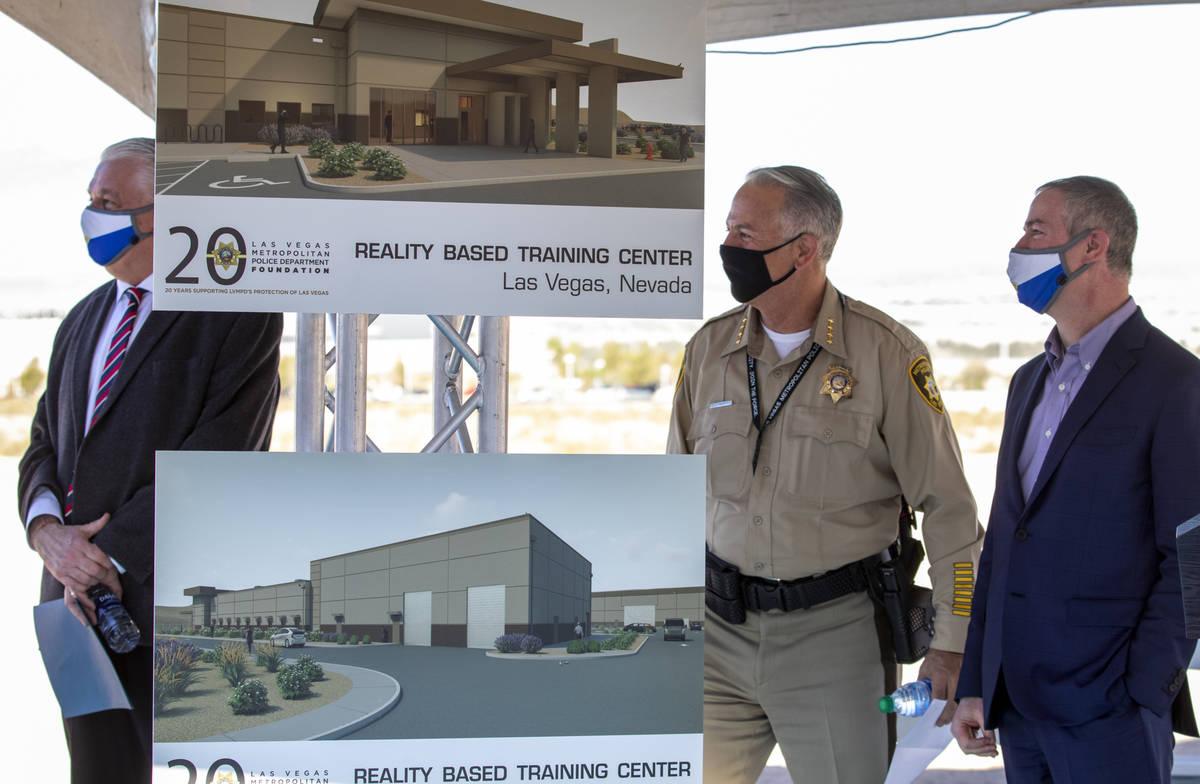 Governor Steve Sisolak, left, Sheriff Joseph Lombardo, center, Executive Director of the LVMPD ...