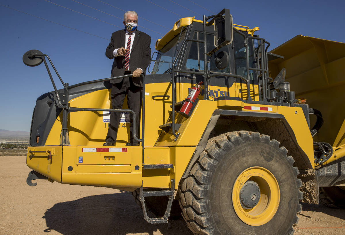 Governor Steve Sisolak jokingly asks for the keys to a dumpster during a press conference on th ...