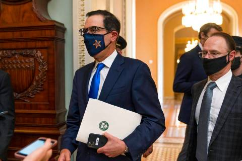 Treasury Secretary Steven Mnuchin, makes a brief comment as he leaves the Capitol, Wednesday, S ...
