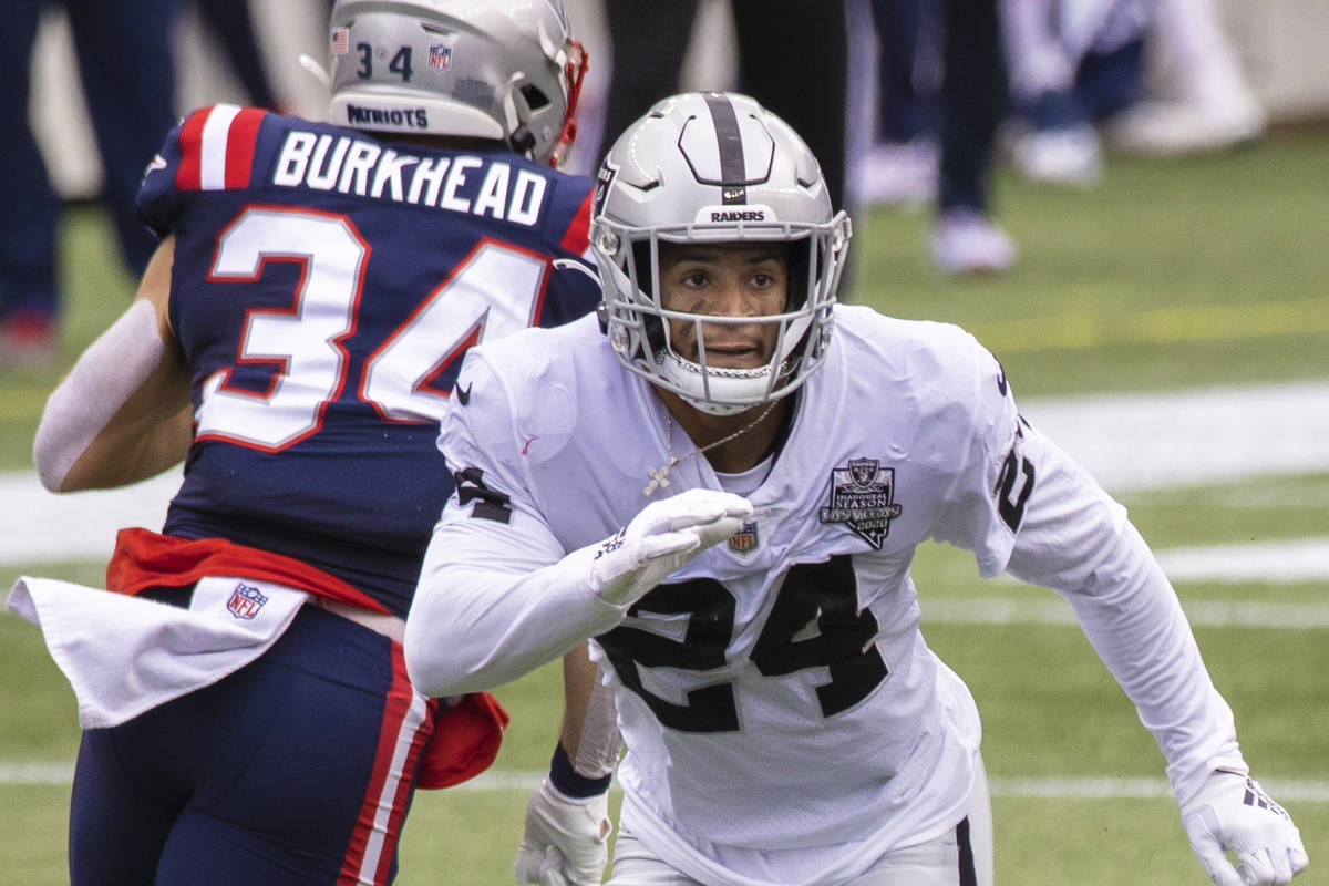 Las Vegas Raiders strong safety Johnathan Abram (24) blitz's past New England Patriots r ...
