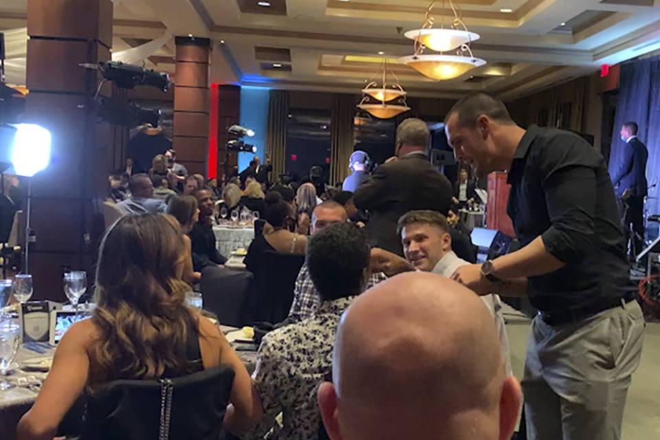In this still image taken from video, Las Vegas Raiders quarterback Derek Carr, right, meets wi ...
