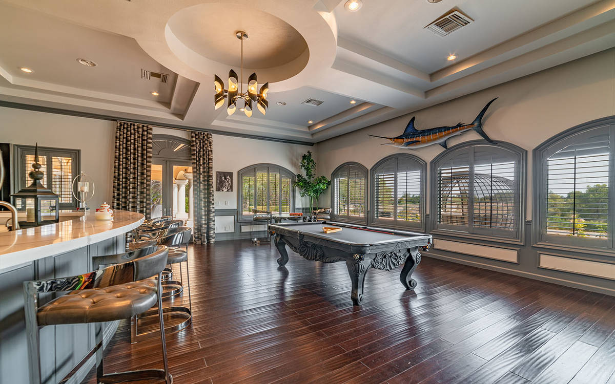 Luxurious Real Estate The main level of the home has a billiards room with extensive wet bar an ...