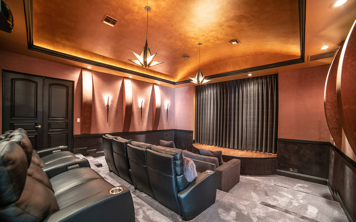 The movie theater is on the main level of the Queensridge home. That level also has a three-qua ...