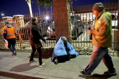 Homeless count volunteers on Las Vegas Boulevard near Foremaster Lane in downtown Las Vegas Wed ...