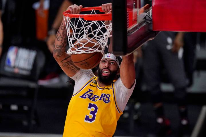 Los Angeles Lakers' Anthony Davis (3) slams a dunk against the Miami Heat during the second hal ...