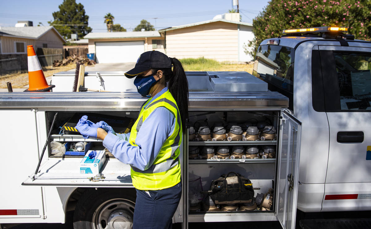 Letty Valenzuela, field technician at Las Vegas Valley Water District, puts on gloves as she ch ...
