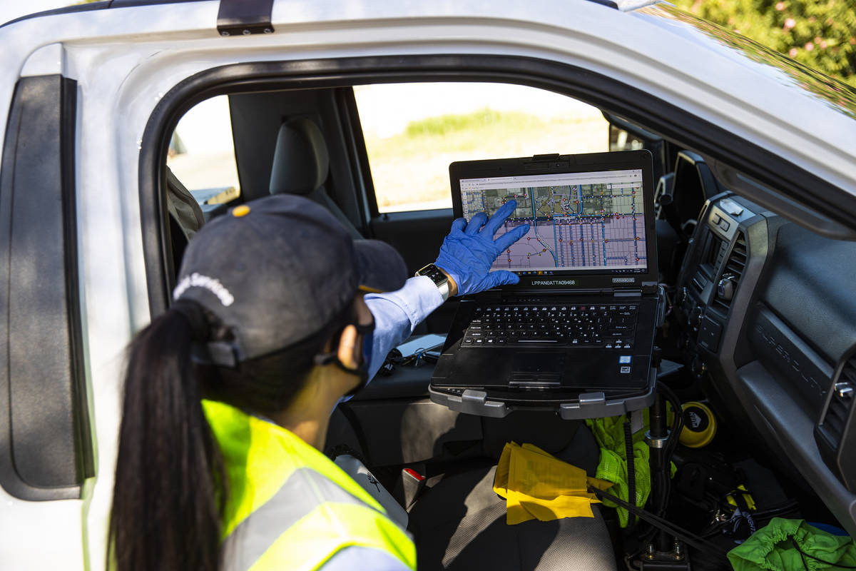 Letty Valenzuela, field technician at Las Vegas Valley Water District, looks at her laptop whil ...